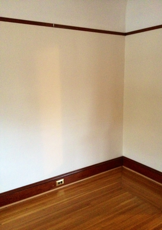 Empty corner in living room waiting for something, but what?